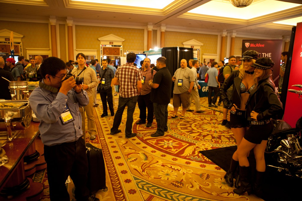 Black Hat Attendee Photographing Booth Babes