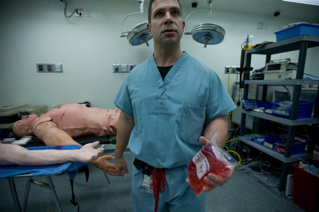 Dr. DJ Green Holding an IV Bag of Fake B