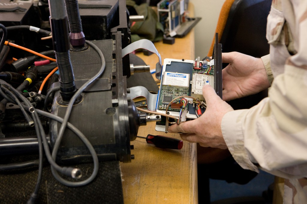 Technician Working on Foster-Miller Robot's RF Module